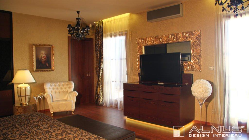 design komody s výsuvnou tv v interiéru ložnice
